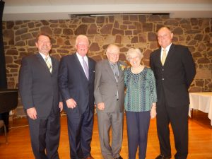 Rev. Thomas Maurer (left), Vice Chair, Cornwall Manor Board of Trustees; Curtis Walizer (second from left), Chair, Cornwall Manor Board of Trustees and Steven Hassinger (right), President, Cornwall Manor congratulate The Rev. Robert and Jean Stokes on receiving the 2016 Founders Day Award.