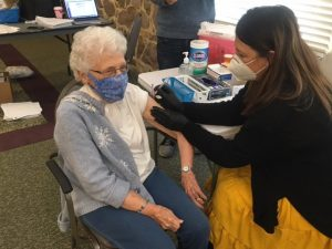 Cornwall Manor resident receiving COVID-19 Vaccine